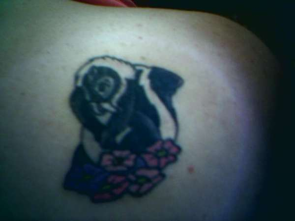 Flower the skunk tattoo