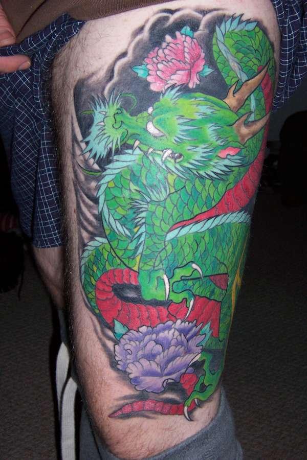 Dragon, left thigh tattoo