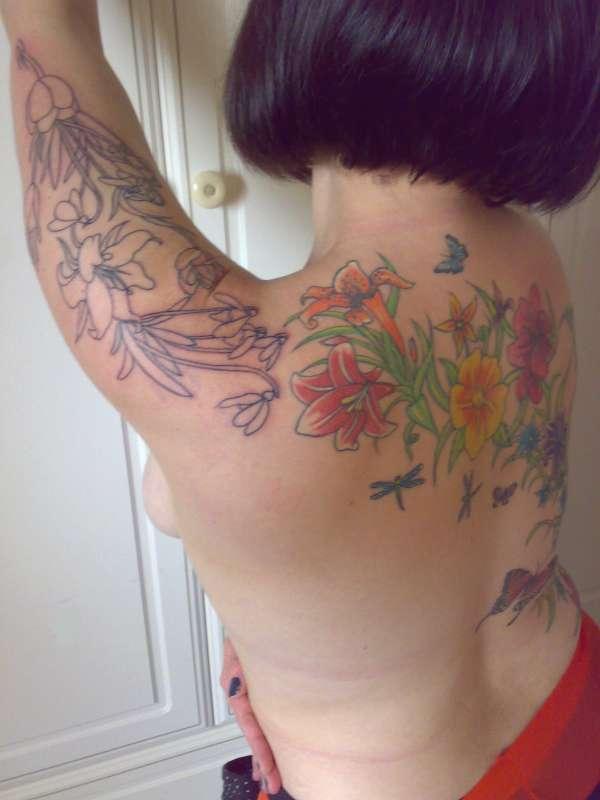 Flower back tattoo......continued....arm tattoo