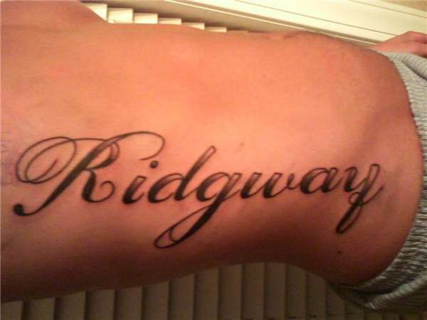 Last name side piece tattoo for Last name tattoos on back