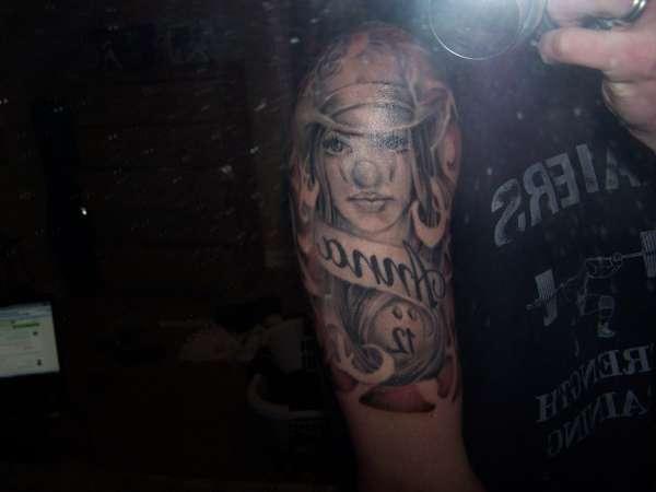 clown around tribal tattoo