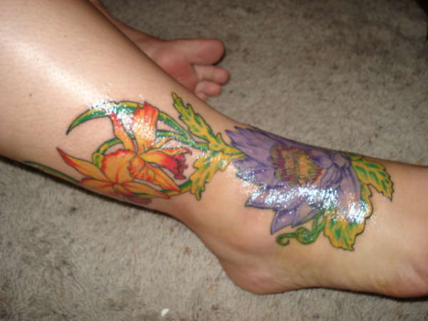 Lotus & Orchids tattoo