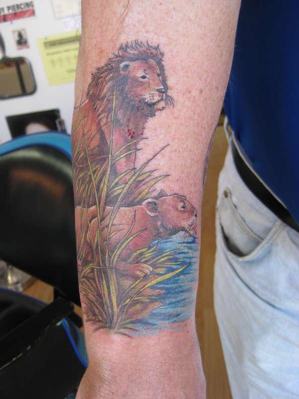 LION LOWER  right arm tat tattoo