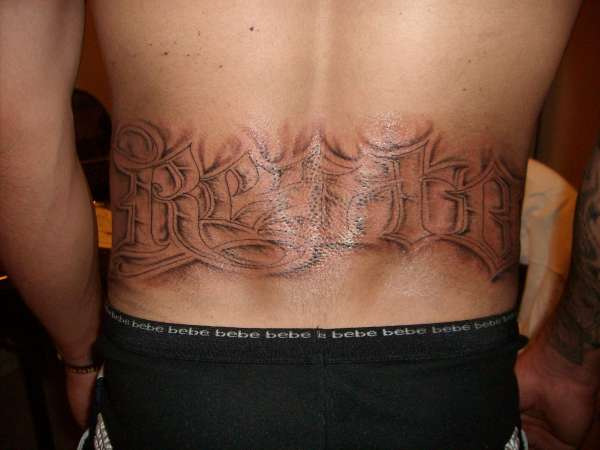Last name on lower back tattoo for Last name tattoos on back