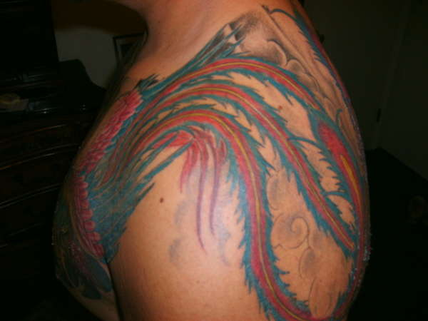 phoenix tale over the shoulder tattoo