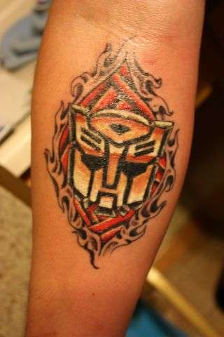 http://static.ratemyink.com/images/ul/908/AUTOBOTS-tattoo-90846.jpeg