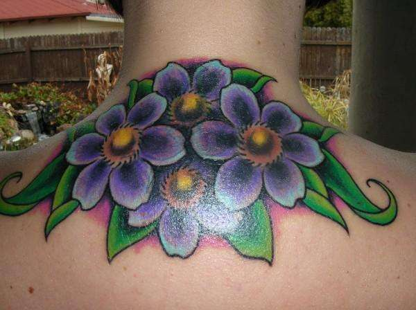 Flower cover-up tattoo