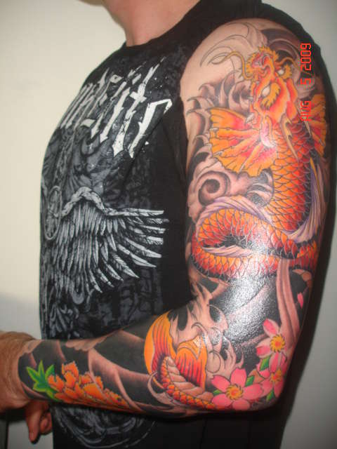 Black and Orange Dragon tattoo