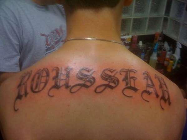 Last name on back tattoo for Last name tattoos on back