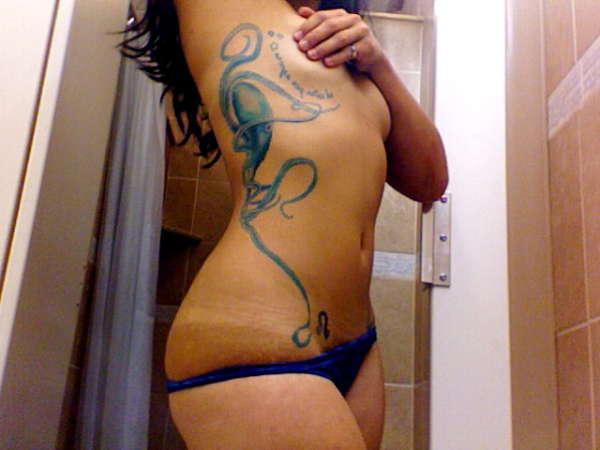 Blue Octopus by Jesse Britten tattoo