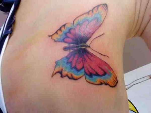 large butterfly cover-up tattoo