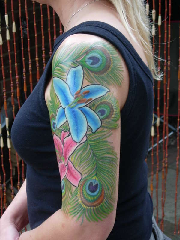 peacock feathers and lillies tattoo