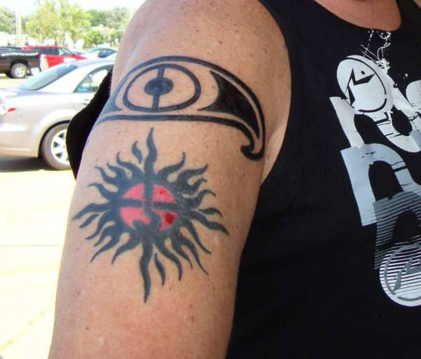 tribal sun w/ the sign of kronos tattoo