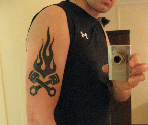 Crossed Pistons and Flames tattoo