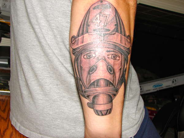 bee425ab1 Firefighter face back of forearm tattoo