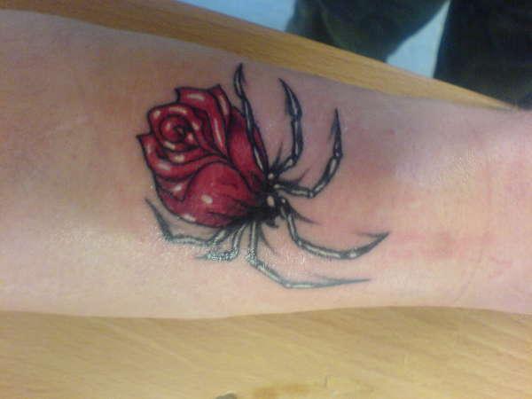 a spider rose tattoo