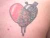 rebuilding heart decay tattoo