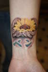 sunflower n hands tattoo