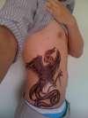 Phoenix on my ribs tattoo