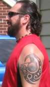 Leonidas with tribal wolf tattoo