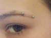 Horizontal Eyebrow Piercing tattoo