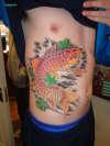 koi on ribs tattoo