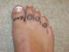 daisy's on toes tattoo