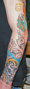 unfinished jail style sleeve tattoo