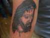 Jesus on the back of an arm... tattoo