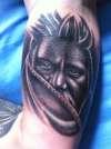 Native inner arm tattoo
