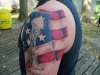 soldiers cross with flag tattoo