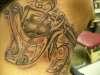 tattoo machine on neck tattoo