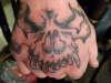 A skull on hand tattoo