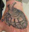ink bottle hand grenade tattoo