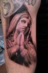 virgin statue tattoo