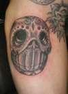 weird skull thing tattoo