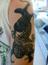 black grey wash dragon arm tattoo