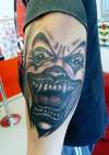 crazy evil clown grey wash mens arm tattoo