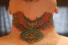 throat owl tattoo