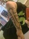 Cross on forearm tattoo