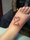 Open heart tattoo