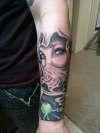 Martini Genie forearm tatt. tattoo