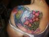hummingbird flying with flowers tattoo