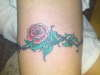 rose and wire tattoo