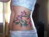 side vines and flowers tattoo