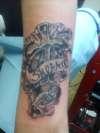 Chrome Cross tattoo