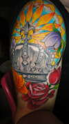 Crown and flower half sleeve tattoo