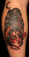 severed head raven tattoo