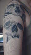 skull half sleeve half done tattoo