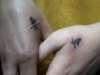 symbol on two girls tattoo
